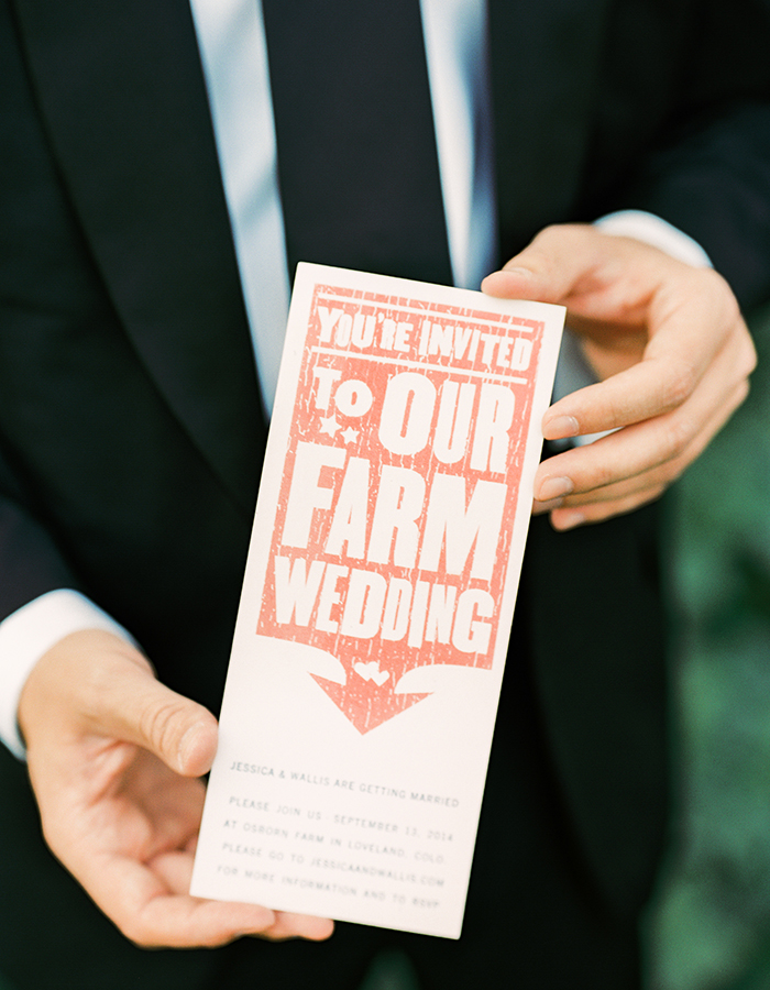 Groom Holding Invite, Danielle DeFiore Photography