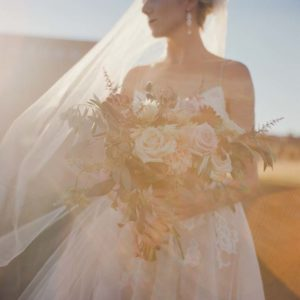 Devil's Thumb Ranch Wedding, Colorado Bride Holding Bouquet