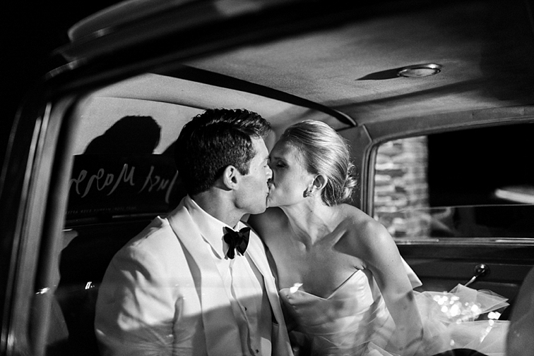 Kiss in the Wedding Car - Denver Wedding Photos, Cherry Hills Country Club