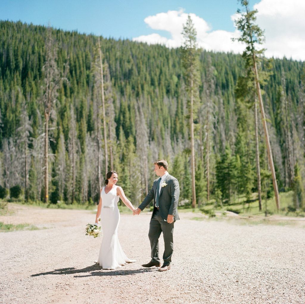 Vail Colorado Wedding, Colorado Wedding Photographer, Film Photographer, Mountain Wedding, Colorado Destination Wedding Photographers, Best Photographers In Colorado, Film Photography, Denver Wedding Photographers, Bride and Groom Hand In Hand, DeFiore Photography, Piney River Ranch