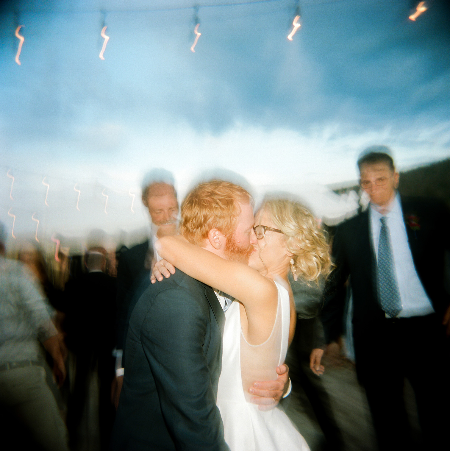 Destination Wedding in Colorado, Bride Groom Kissing on Dance Floor, Holga Photography,
