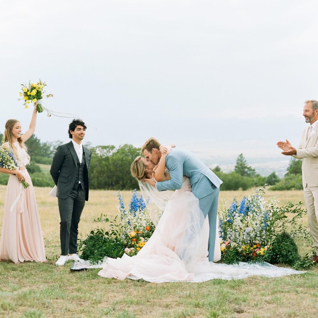 Colorado Wedding Photographers, bride groom kissing, summer Colorado mountain ceremonies,
