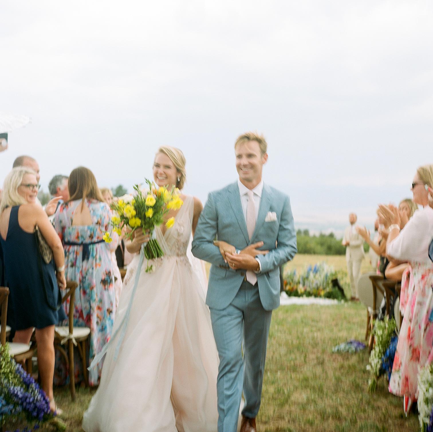 Colorado Wedding Photographers, Mountain Ceremonies, Bride and Groom Walking to Reception