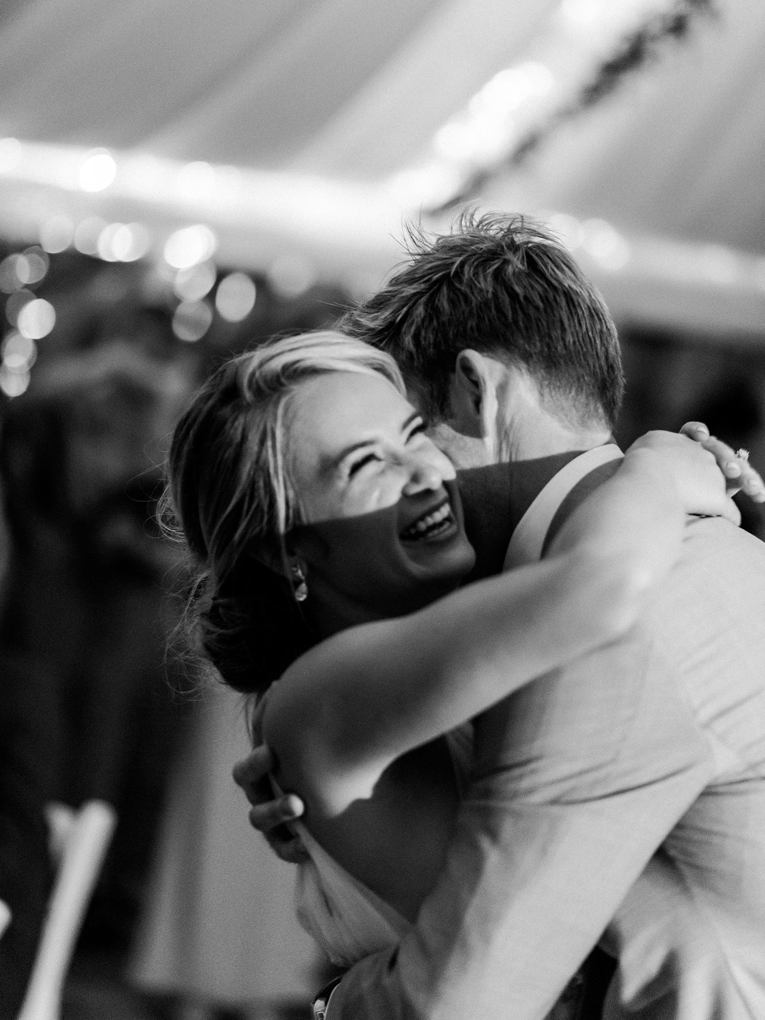 Wedding Photographers Colorado, Best Creative Wedding Photographers in Colorado, Bride Laughing During Dances, Black and White Wedding Photos