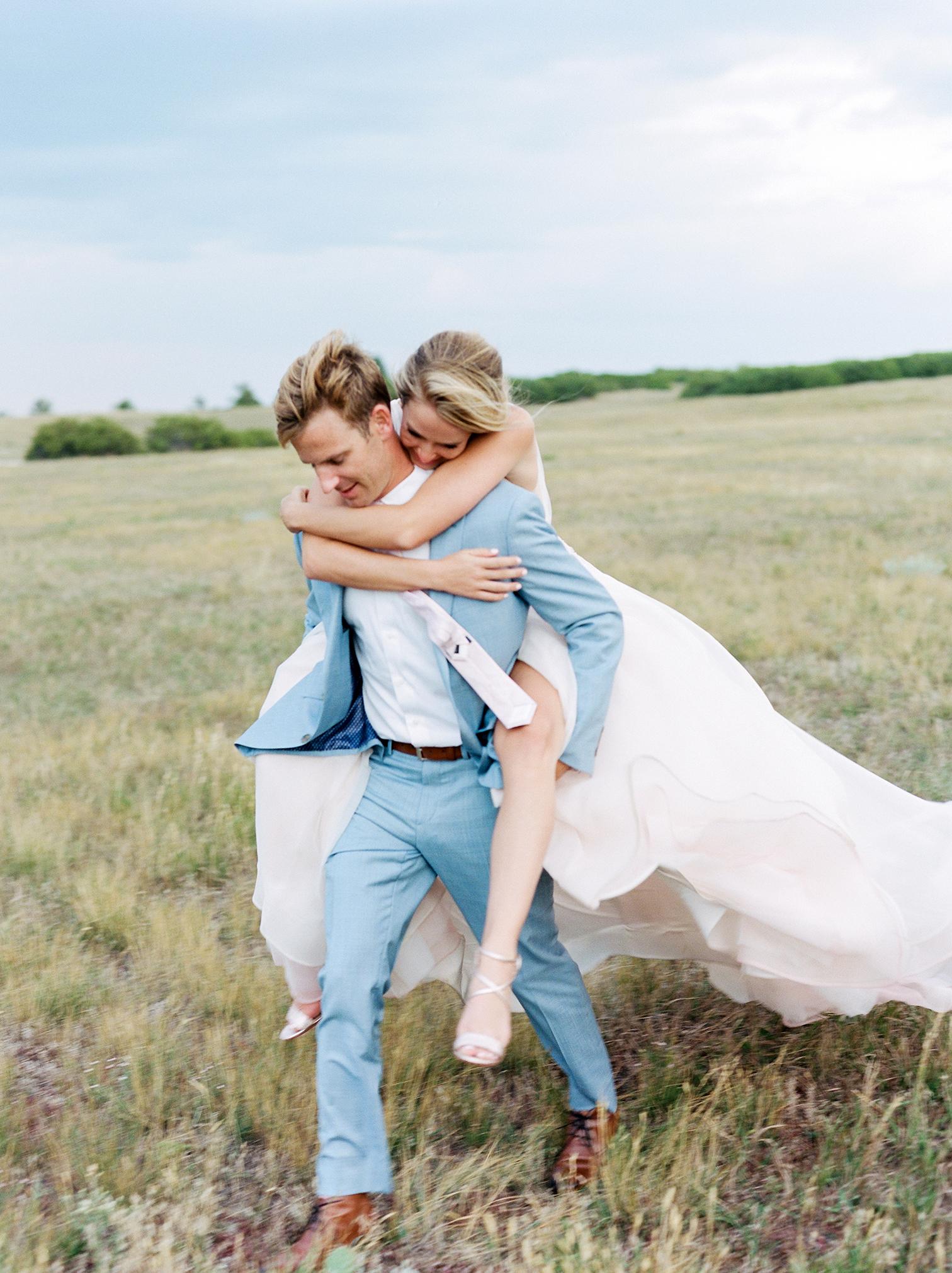 Wedding Photographers Colorado, Best Photography, Denver Wedding Photos, Groom Carrying Bride in Mountains, Fine Art film Photographers in Colorado