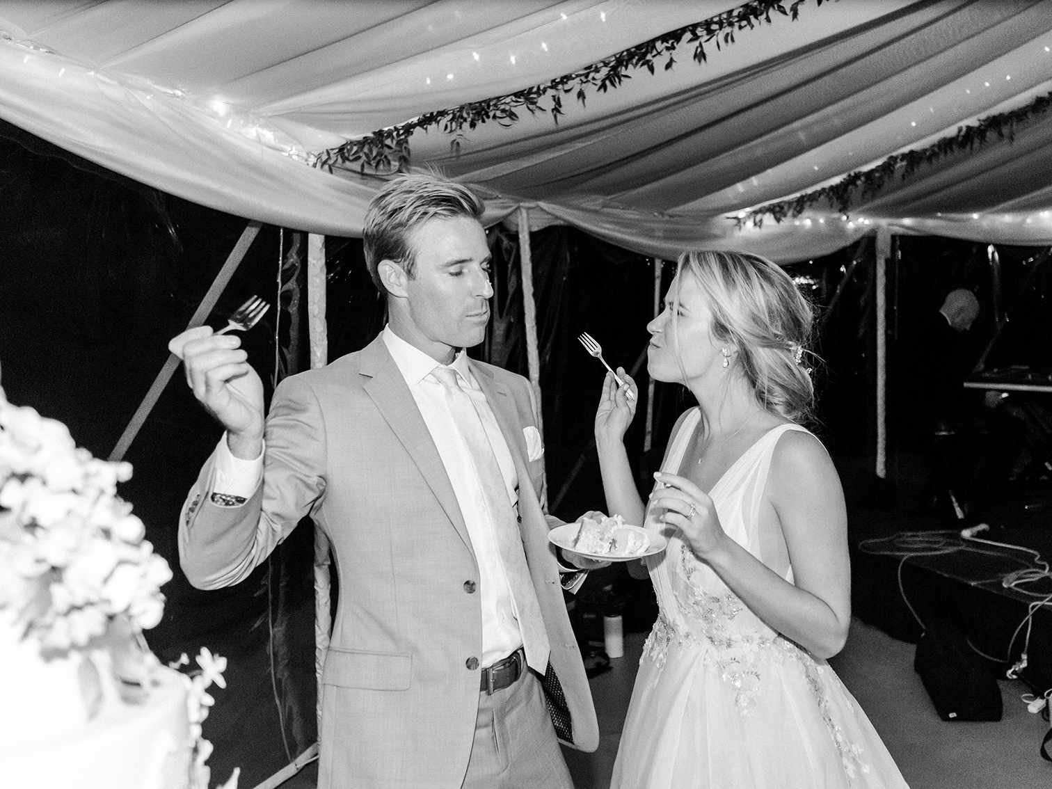 Wedding Photographers Colorado, Bride and Groom Eating Cake, Candid Moments, Black and White Wedding Photos
