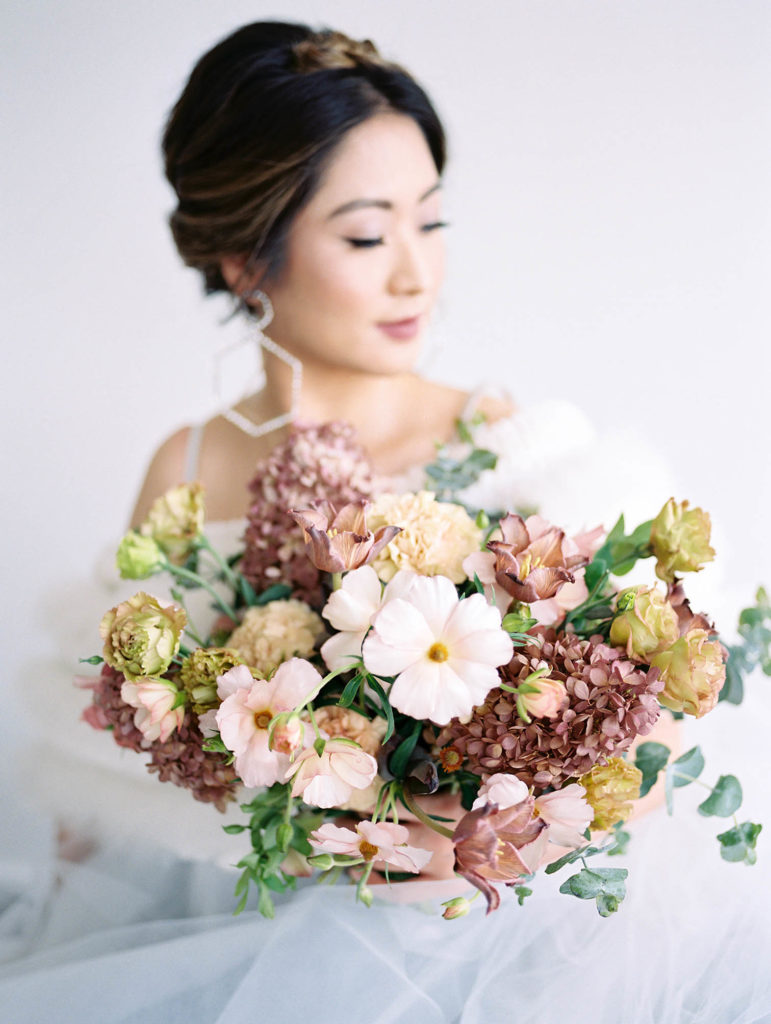 Colorado weddings, Florist, romantic wedding, wedding colors, Danielle Defiore Photography, bride holding bouquet, film photography