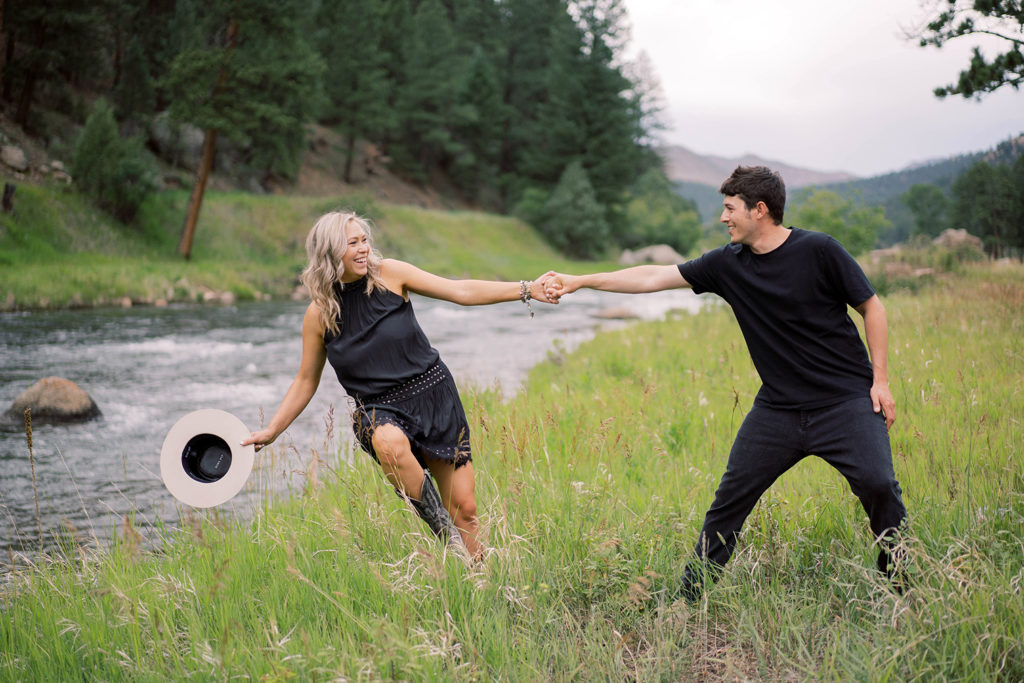 Colorado Mountain Engagement Photos, Playful couple by river
