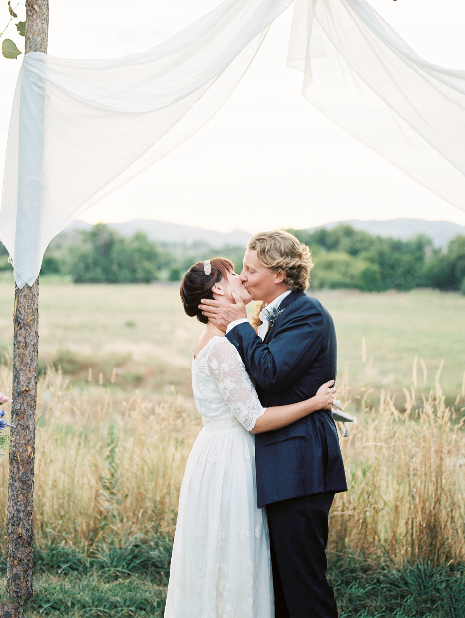 getting married in aspen, bride and groom kissing
