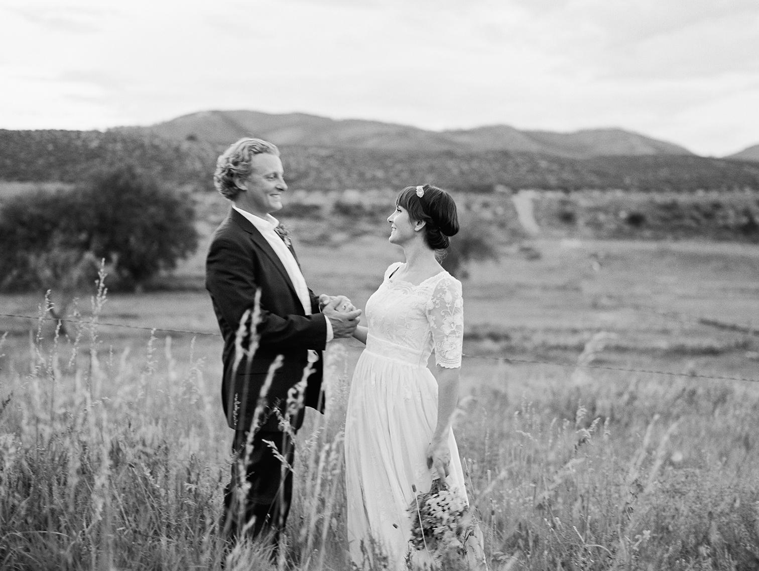 wedding photographers in Aspen, bride and groom standing in valley
